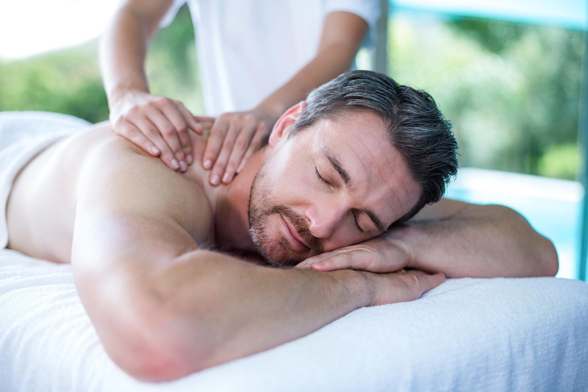 Handsome man massage stock photo footage